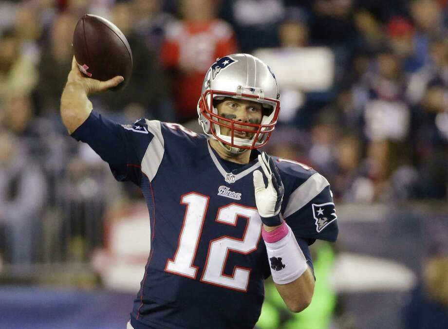 New England Patriots quarterback Tom Brady (12) passes the football during the first half of Sunday's game against the Cincinnati Bengals in Foxborough, Mass. Photo: Stephan Savoia — The Associated Press   / AP