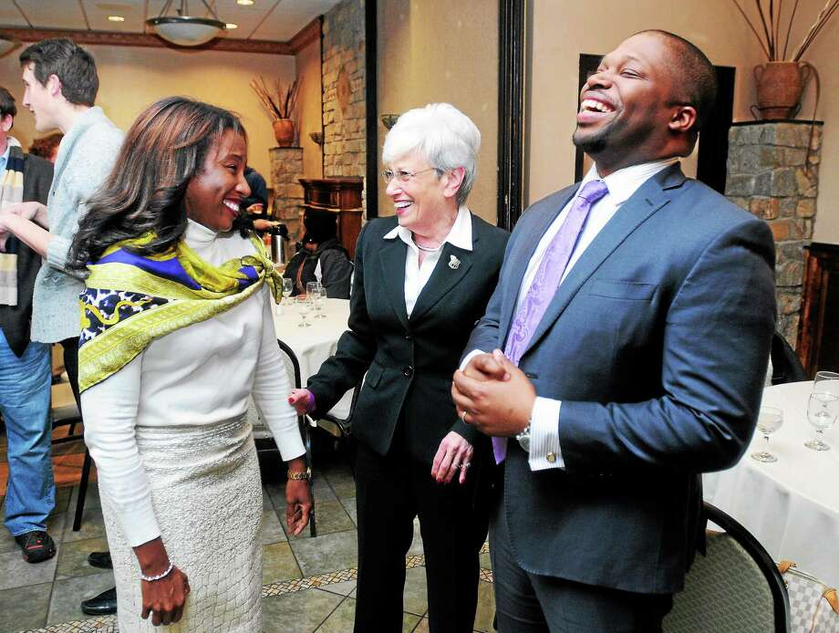 Gary Holder-Winfield, right, celebrates with his wife, Natalie, left, and Lt. Gov. Nancy Wyman as results for the 10th District state Senate race are displayed at the Greek Olive Restaurant in New Haven Tuesday night. Photo: Arnold Gold — New Haven Register