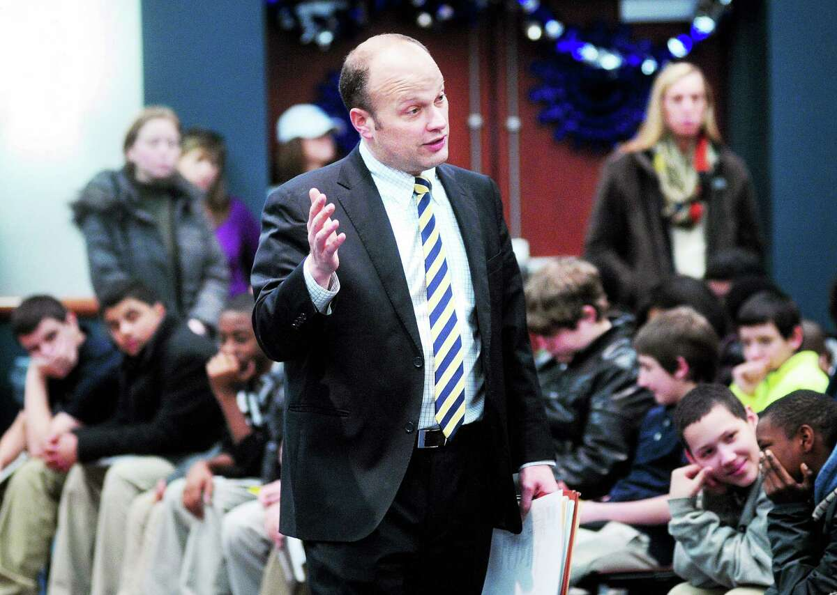 Superintendent of Schools Garth Harries talks with eighth-graders during a New Haven High School Fair at Southern Connecticut State University in New Haven in January.