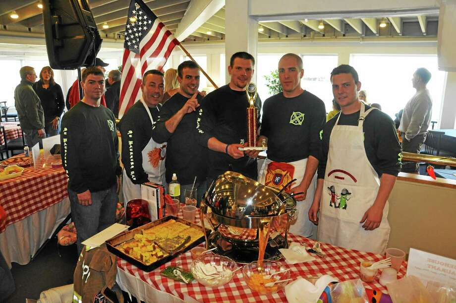 Members of the Milford Fire Department with the Judge's Choice trophy they won at the 2012 Chili Festival. Contributed photo Photo: Journal Register Co.