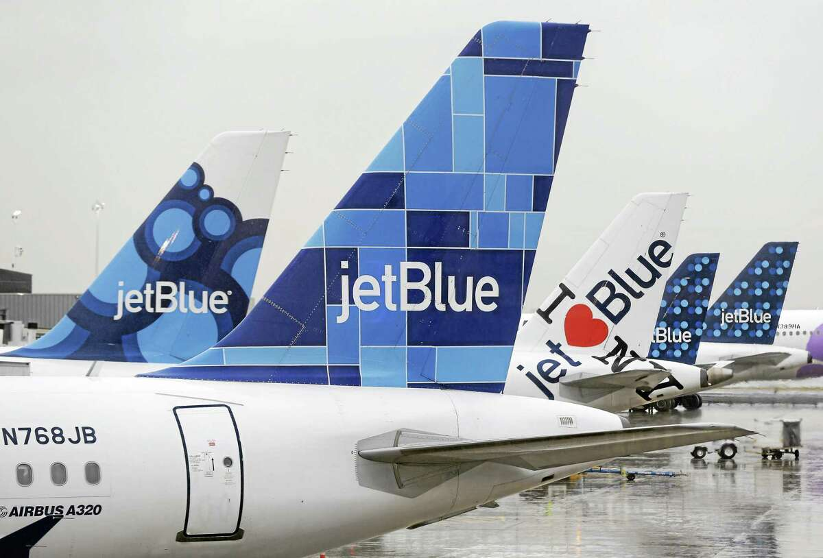 JetBlue airplanes at their gates at John F. Kennedy Airport in New York.