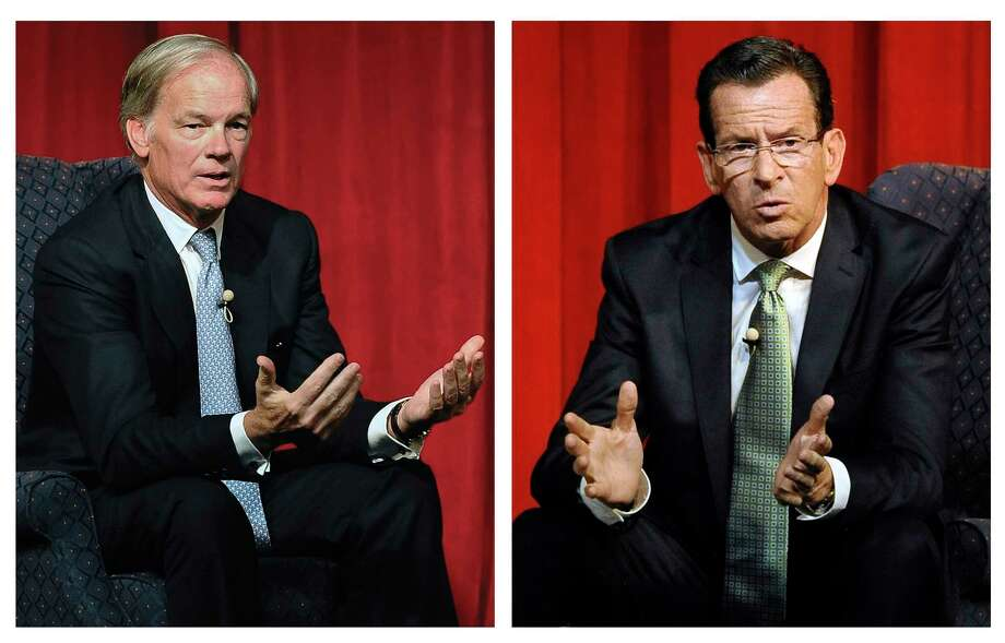 Republican candidate for governor Tom Foley, left, and incumbent Democrat Gov. Dannel P. Malloy, right, deliver their closing remarks at the conclusion of a debate in Norwich, Conn. Photo: AP Photo/Jessica Hill   / FR125654 AP