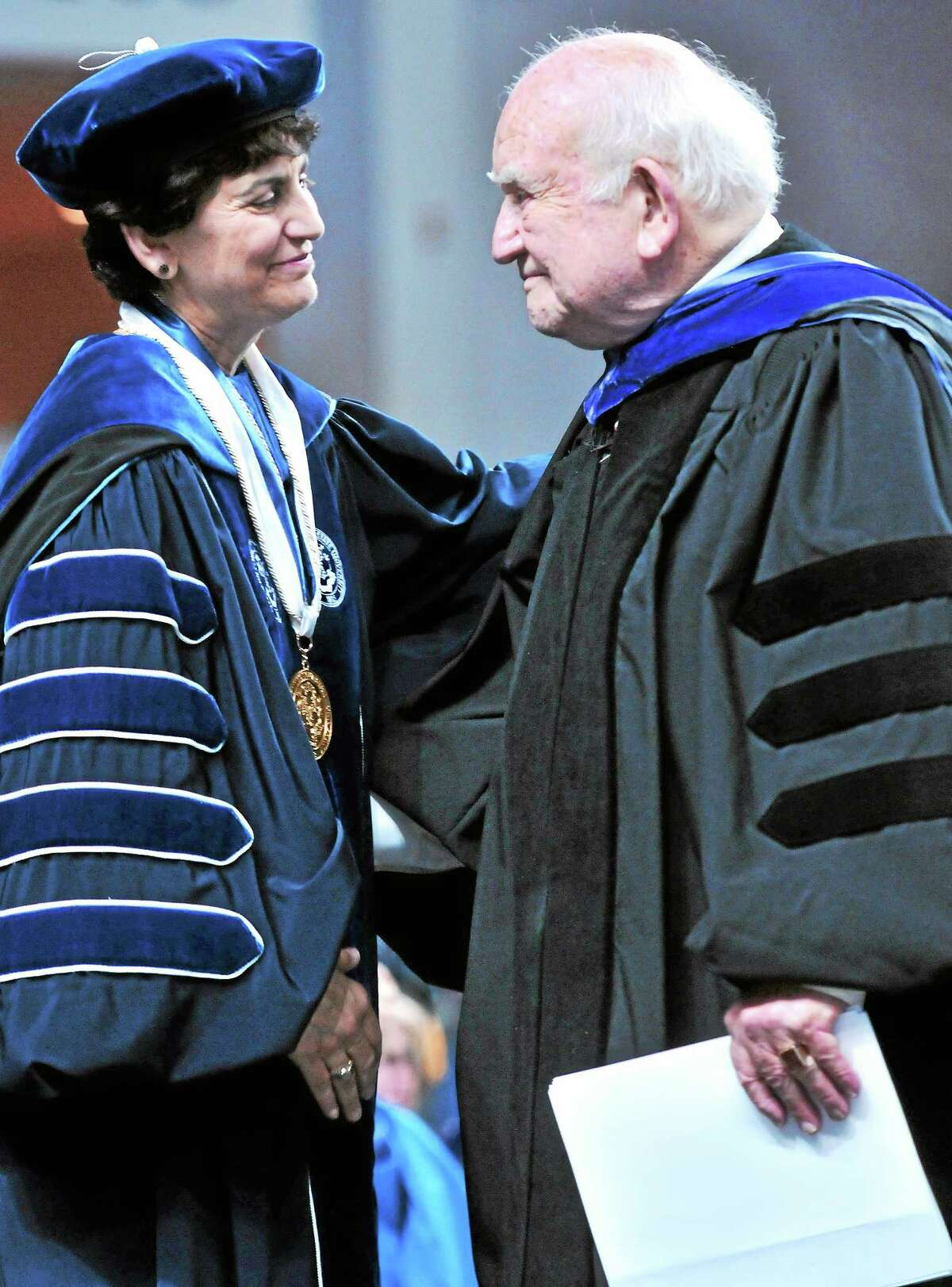 Southern Connecticut State University President Mary Papazian, left, and Edward Asner embrace after Asner gave the Undergraduate Commencement address for Southern at Webster Bank Arena in Bridgeport in May.