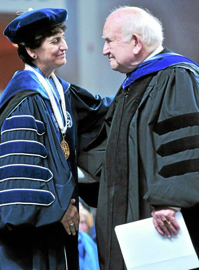 Southern Connecticut State University President Mary Papazian, left, and Edward Asner embrace after Asner gave the Undergraduate Commencement address for Southern at Webster Bank Arena in Bridgeport in May. Photo: Arnold Gold — New Haven Register