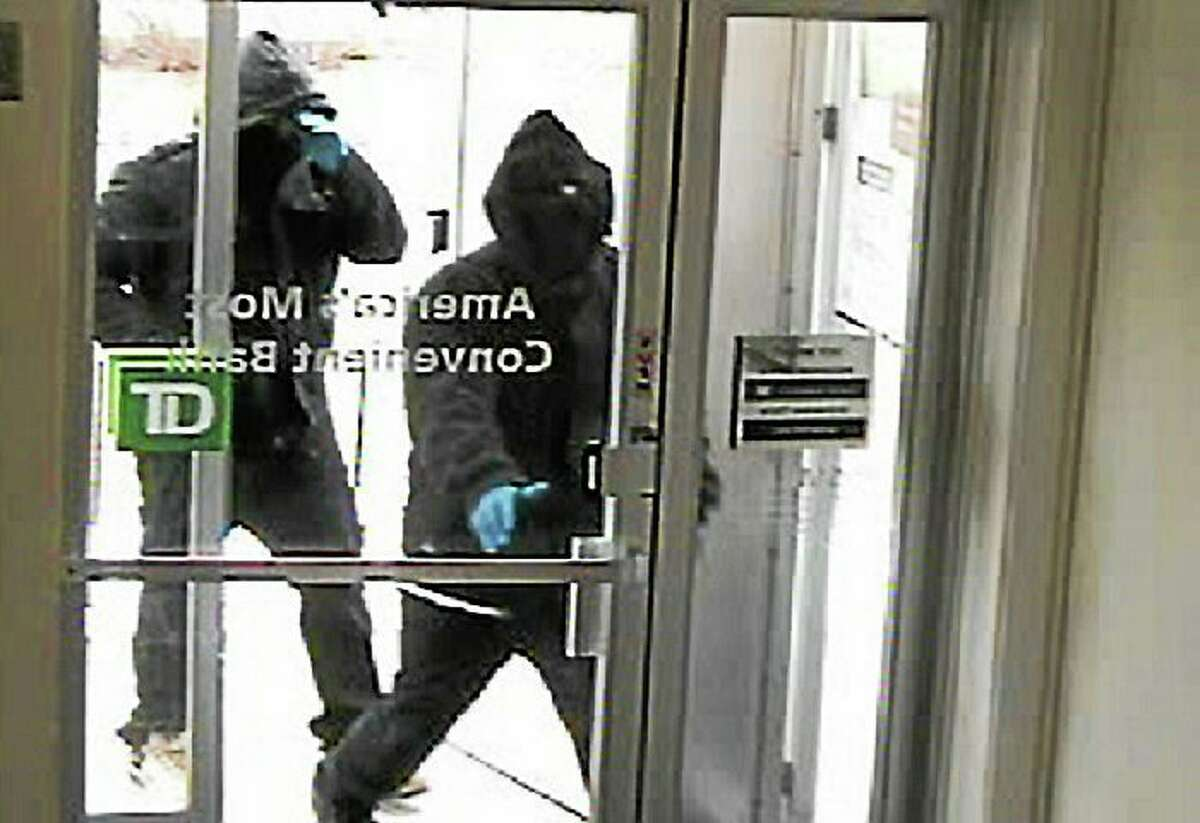 Police say this image from a video surveillance camera shows two men entering the TD Bank branch, 128 Amity Road, in March 2014 before the bank was robbed.