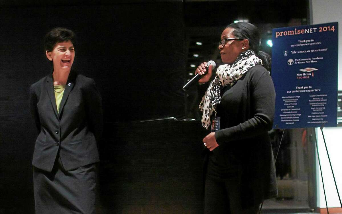 New Haven Promise Executive Director Patricia Melton, right, and Southern Connecticut State University President Mary A. Papazian, who sits on the New Haven Promise board, attend the reception for PromiseNet 2014 held in New Haven Nov. 19-21. Melton and Papazian are attending the White House College Opportunity summit. (Contributed photo - Chris Randall/New Haven Promise)