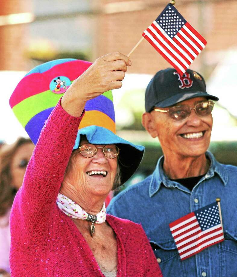 (Mara Lavitt ó New Haven Register)   June 15, 2014 Milford  Milford celebrated its 375th anniversary with a parade through downtown. Maria and Herbert Chmidtke of Milford watch the parade come down River St.  mlavitt@newhavenregister.com Photo: Journal Register Co. / Mara Lavitt