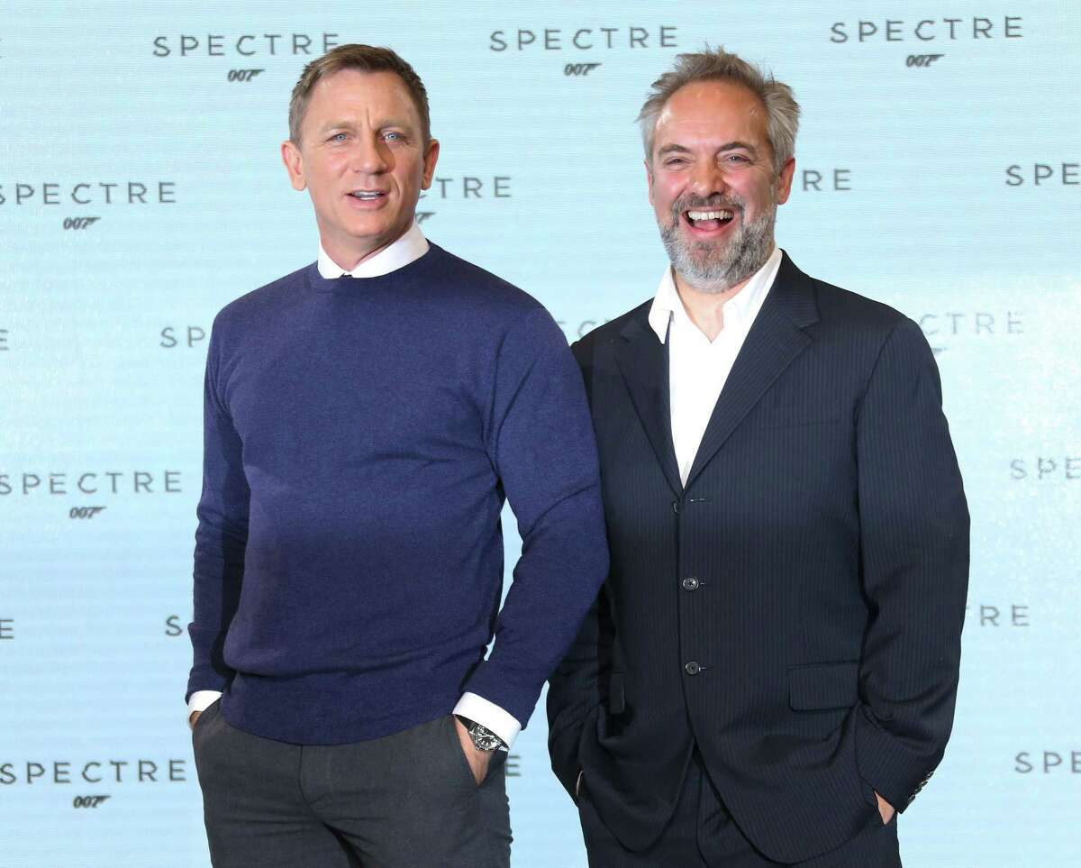 Actor Daniel Craig and Director Sam Mendes pose for photographers pose for photographers at the announcement for the new Bond film, the 24th in the series, at Pinewood Studios in west London, Thursday, Dec. 4, 2014. The titile of the new Bond production is Spectre. (Photo by Joel Ryan/Invision/AP)