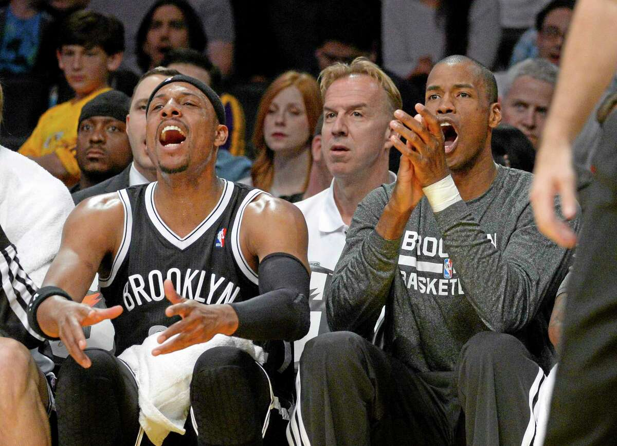 Brooklyn Nets forward Paul Pierce, left, and center Jason Collins cheer from the bench after a Nets basket against the Lakers on Sunday.