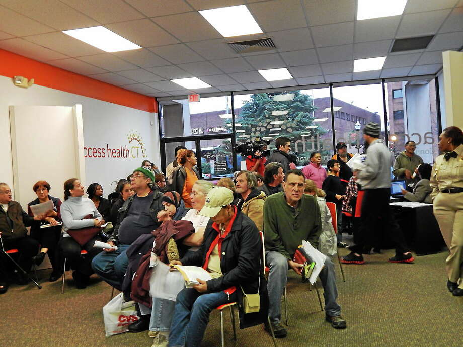CTMirror.org photo  The Access Health enrollment center in New Britain has been enrolling close to 100 people per day in recent days. Photo: Journal Register Co.