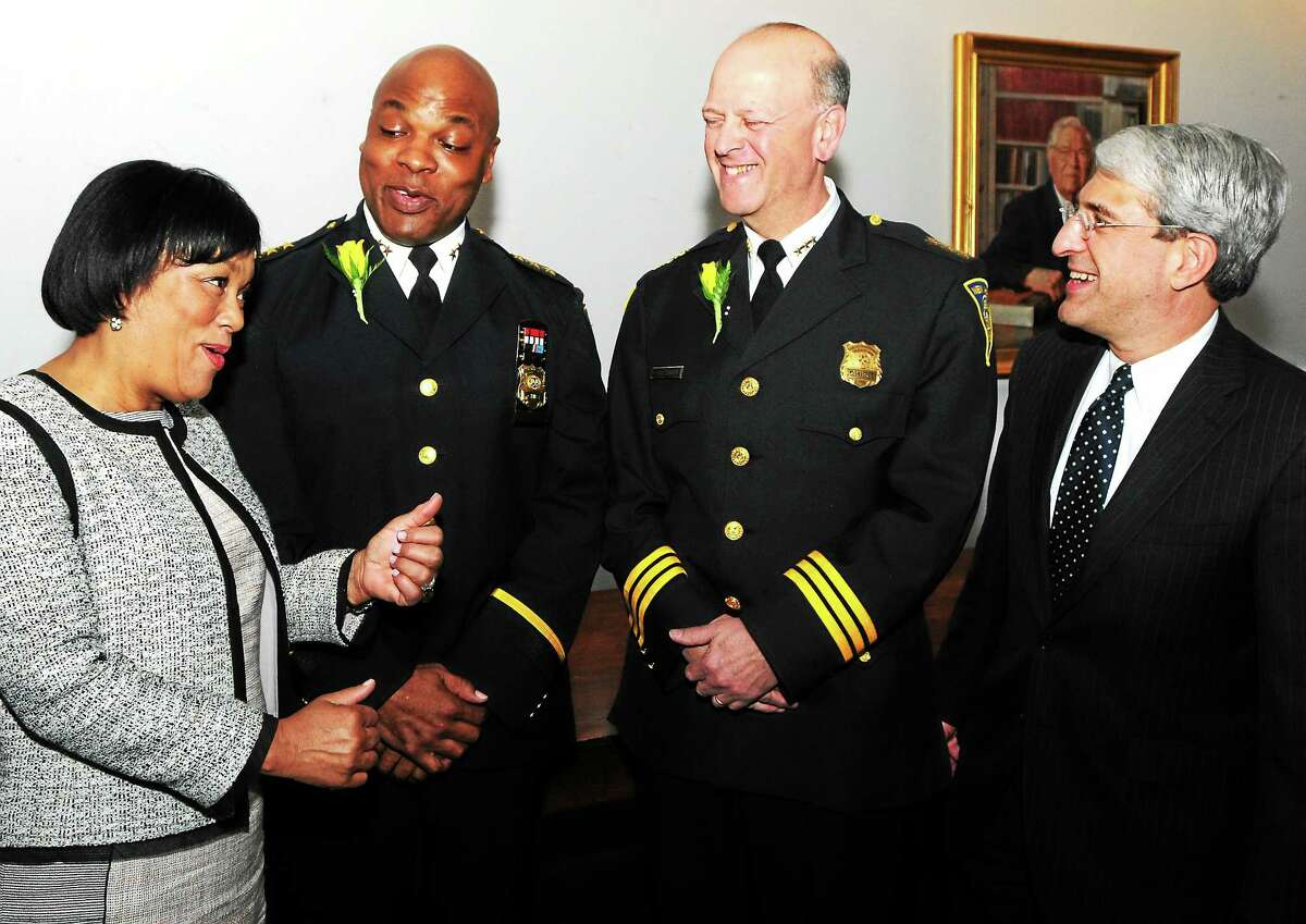 New Haven Mayor Toni Harp, Yale Police Chief Ronnell Higgins, New Haven Police Chief Dean Esserman and Yale University President Peter Salovey at The Seton Elm and Ivy Awards Wednesday April 9, 2014 at Yale University. The two police chiefs were honored at the yearly event.