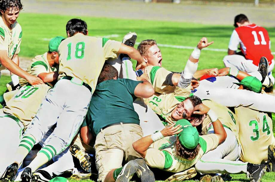 (Melanie Stengel - New Haven Register)      Notre Dame  West Haven celebrates their win over Masuk in the Class LL basebal final 6/14. Photo: Journal Register Co.