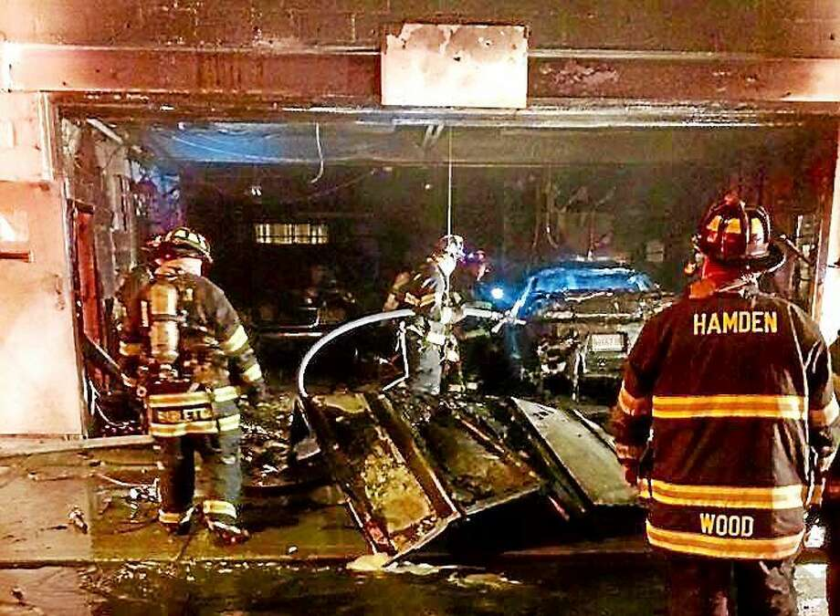 Two cars were destroyed and a garage was damaged after a fire Tuesday night on Cherry Ann Street in Hamden. Firefighters were able to bring the blaze under control quickly. Photo: (Photos Courtesy Of Hamden Professional Firefighters Local 2687)