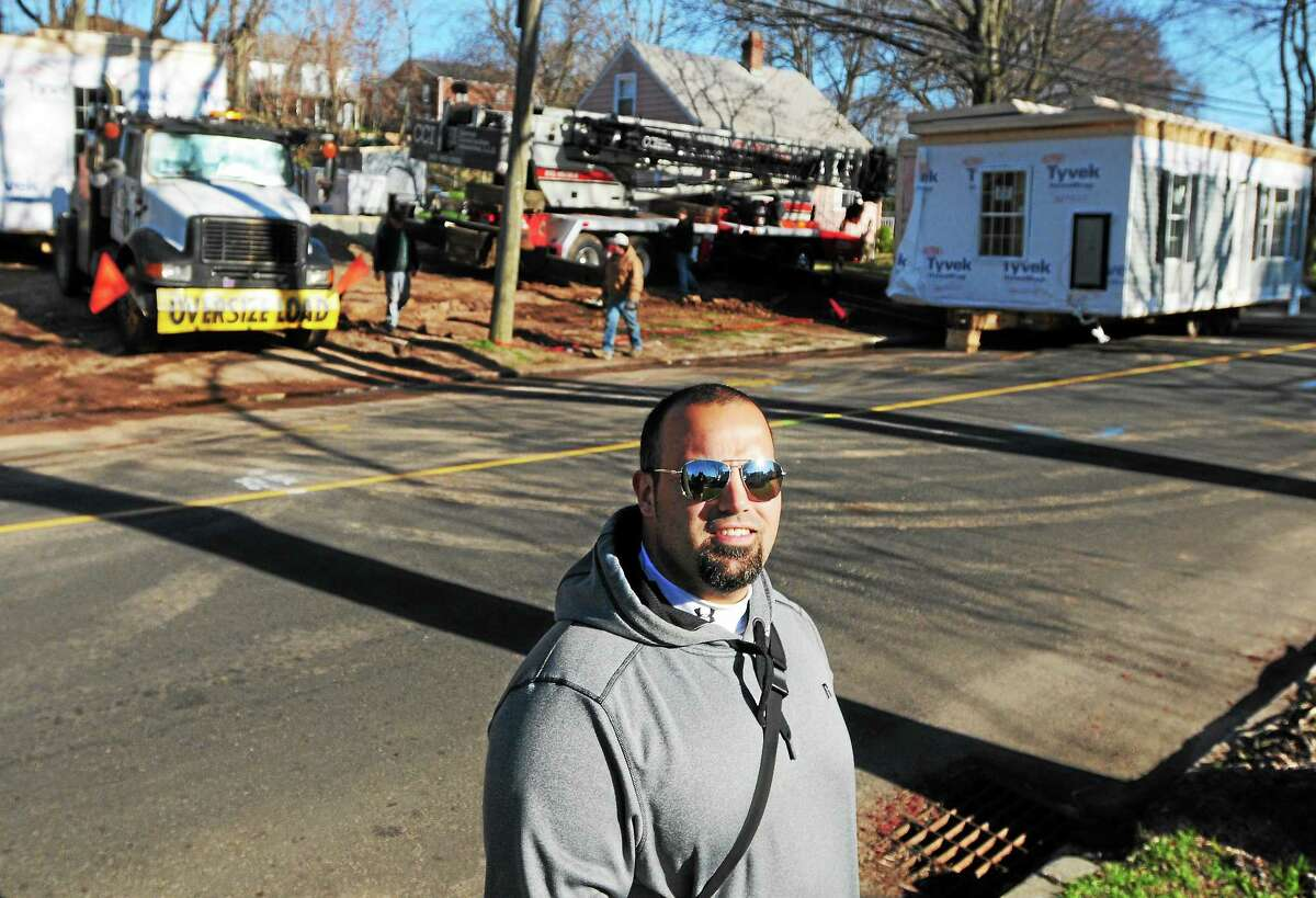 Danny Zurlo, the East Haven resident whose home at 68 Charter Oak Ave. was destroyed in last August's airplane crash, was on hand Thursday to watch the delivery of his new modular home.