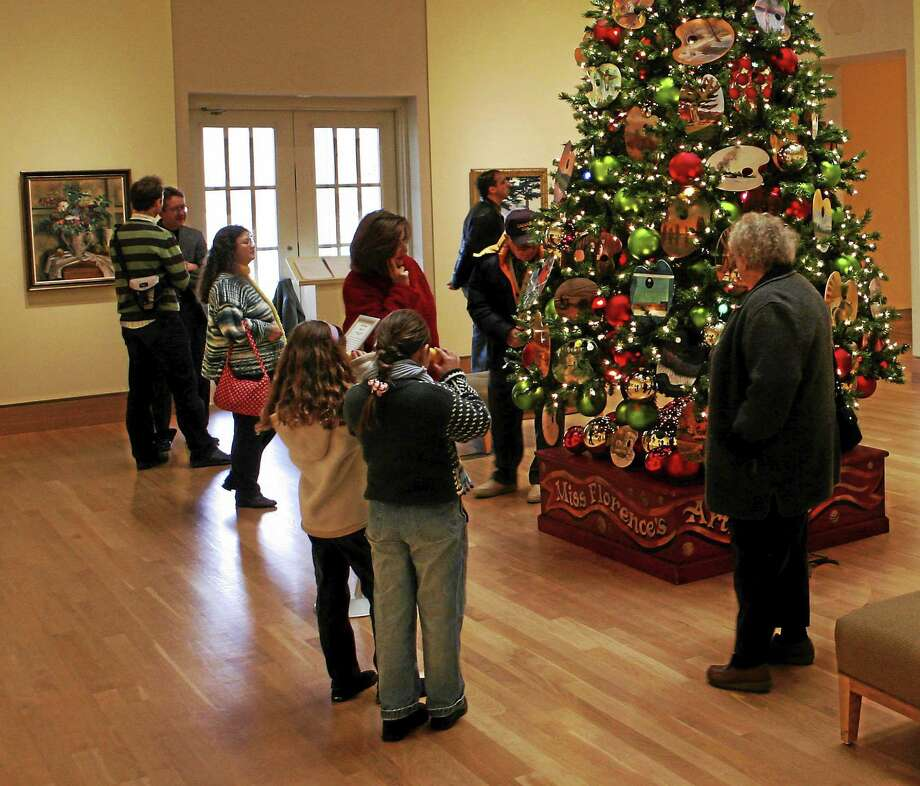the holiday adornment at the flo gris includes christmas trees with palettes painted by artists throughout