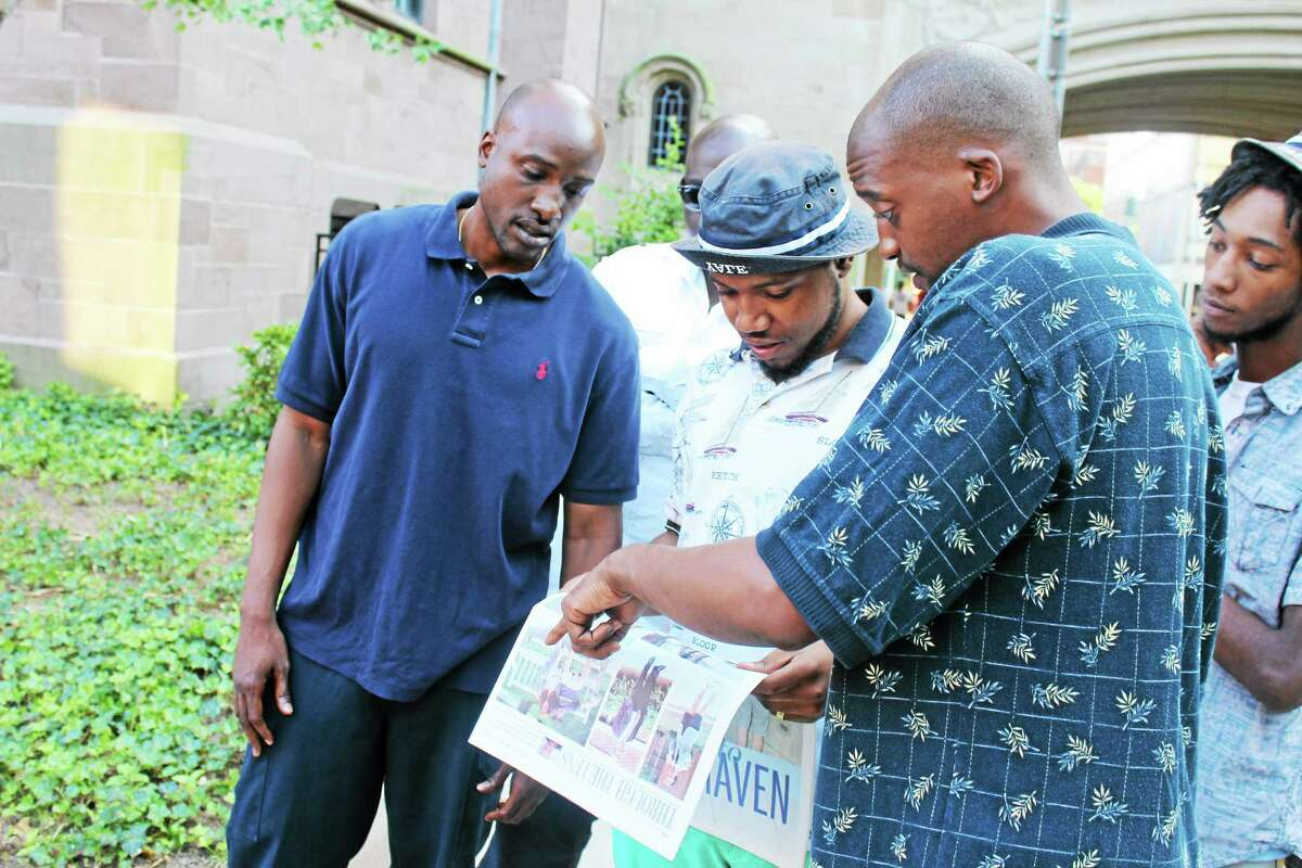 City residents talk about racism over an image shown in Yale Daily News.