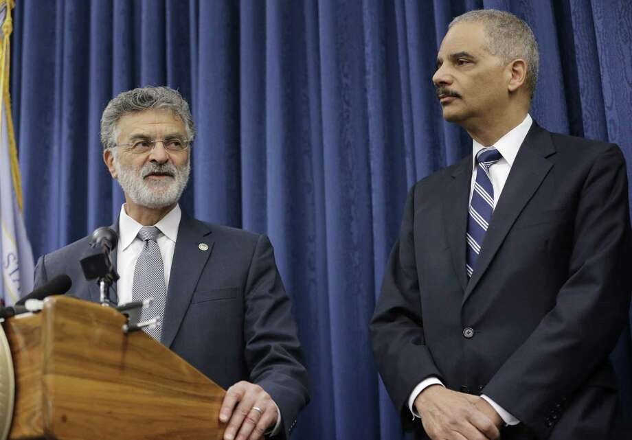 U. S. Attorney General speaks Eric Holder, right, listens as Cleveland Mayor Frank Jackson speaks at a news conference Thursday, Dec. 4, 2014, in Cleveland. The US Justice Department issued a report Thursday that says Cleveland police officers use excessive and unnecessary force far too often, are poorly trained in tactics and firearm use and place the public and their fellow officers in danger because of reckless behaviors. Photo: (AP Photo/Tony Dejak) / AP