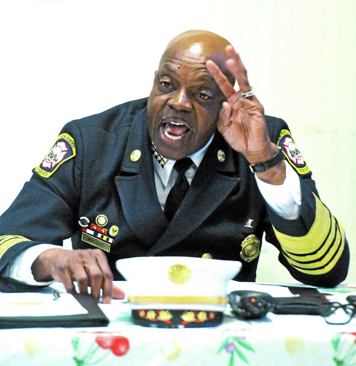 New Haven Fire Chief Allyn Wright speaks during the Greater New Haven NAACP meeting at St. Luke's Church Thursday.