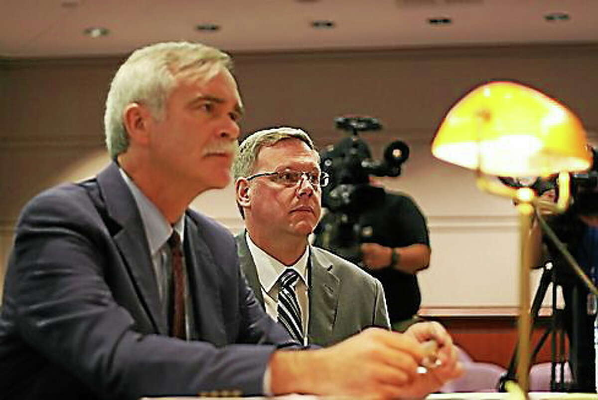 Kenneth Ireland, right, and his attorney William Bloss at a hearing before Claims Commisisoner J. Paul Vance Jr. in July.