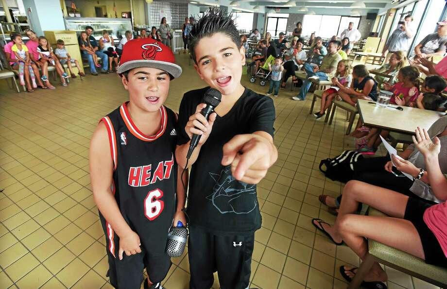 Peter Cestaro, 11, of East Haven with backup singer Eddie Parrette of Branford, 8, left, entertained at the Silver Sands Beach & Tennis Club camp talent show. Photo: (Mara Lavitt — New Haven Register)    / Mara Lavitt