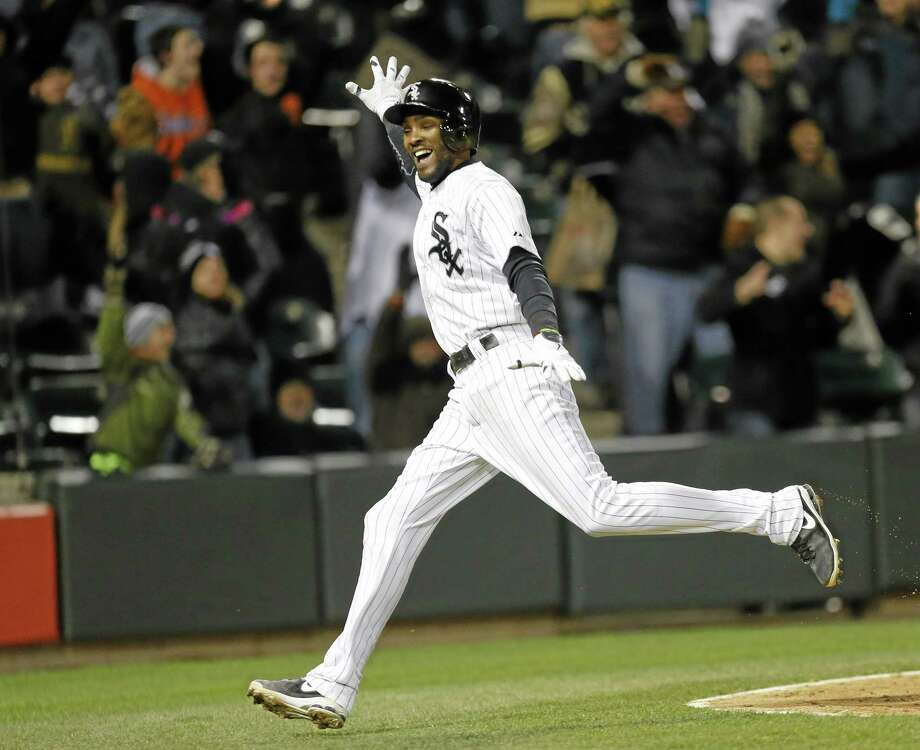 Chicago White Sox's Alexei Ramirez celebrates after scoring the game-winning run off a throwing error by Boston Red Sox shortstop Xander Bogaerts in the ninth inning Tuesday. Chicago won 2-1. Photo: Charles Rex Arbogast  — The Associated Press   / AP