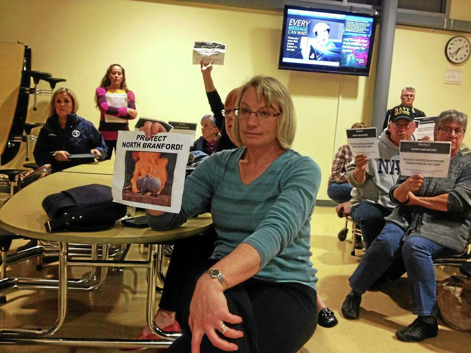 North Branford residents hold signs in silent protest at a meeting of the Conservation and Inland Wetlands and Watercourses Agency. Photo: New Haven Register File Photo