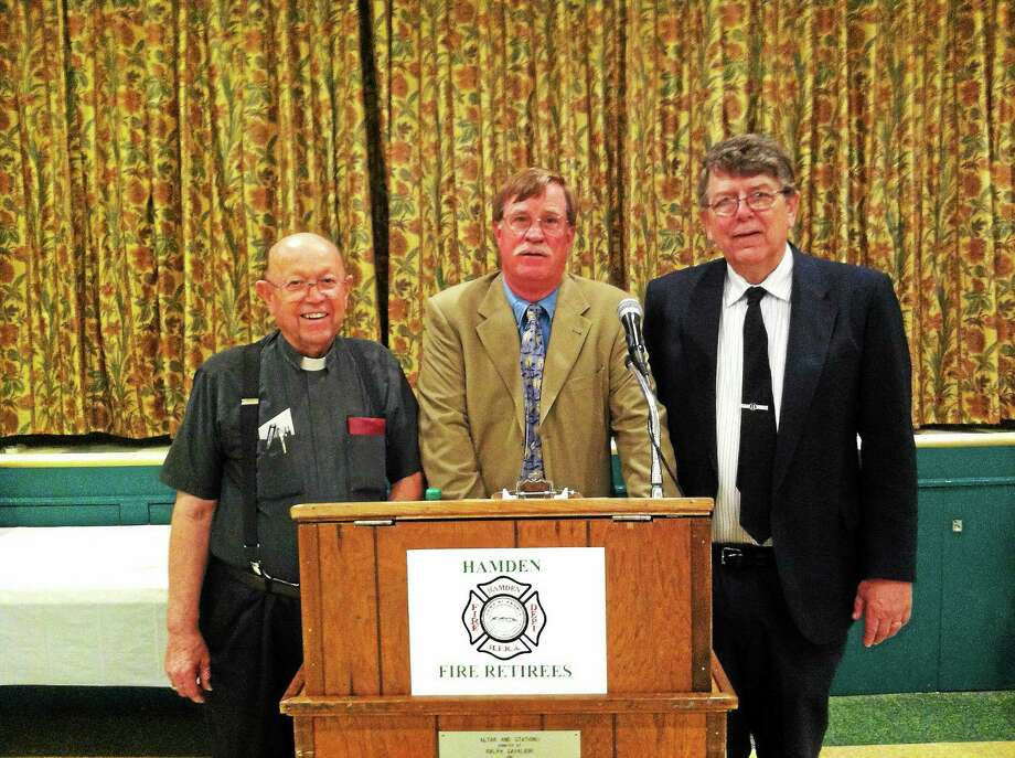From left, the Rev. Owen Sanderson; Robert Mordecai, president of the Hamden Fire Retirees Association; and David Johnson association historian. Photo: Keldy Ortiz — New Haven Register