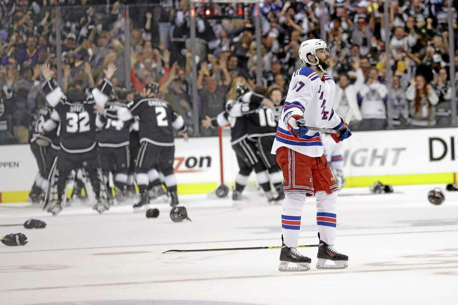 Rangers left wing Benoit Pouliot looks on after losing to the Los Angeles Kings during the second overtime in Game 5 of the NHL Stanley Cup Final. The Kings won 3-2 to clinch their second Stanley Cup in three years. Photo: Gregory Bull  — The Associated Press   / AP