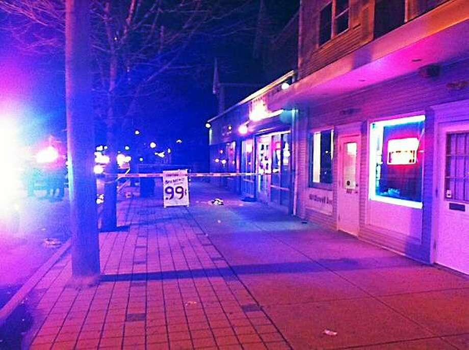 Police investigate a shooting near the corner of Dixwell Avenue and Easton Street. Photo: Keldy Ortiz/New Haven Register