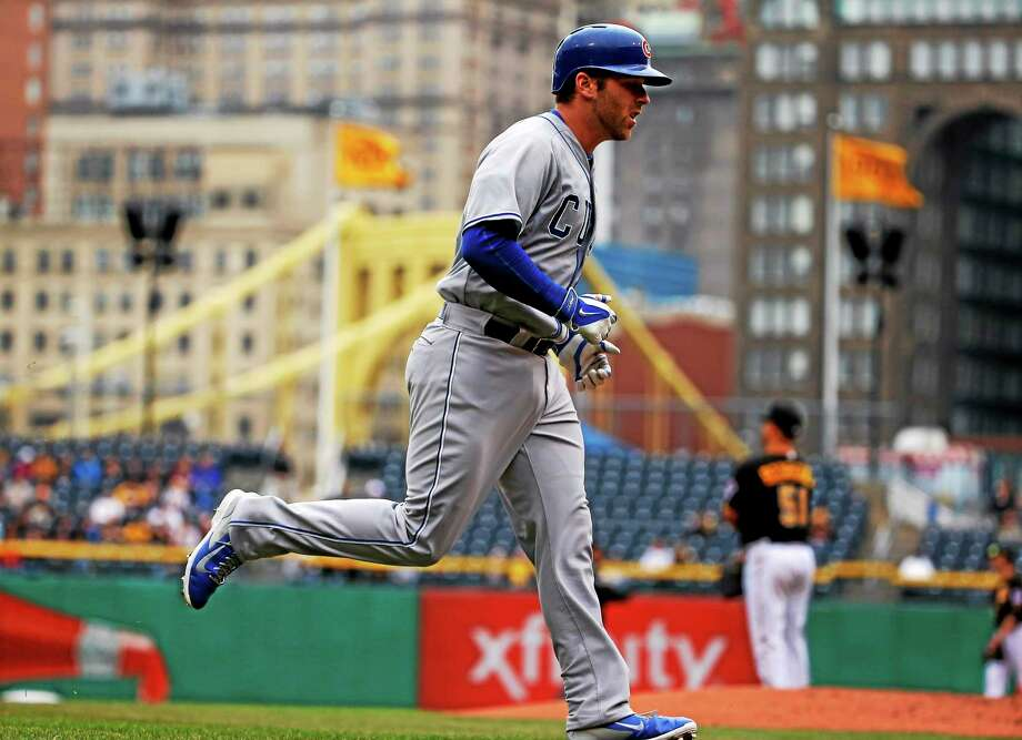 Branford High and UConn product Mike Olt rounds third base after hitting his first major-league home run off Pirates starter Wandy Rodriguez on April 3 in Pittsburgh. Olt and his Chicago Cubs played a doubleheader on Wednesday at Yankee Stadium. Photo: Gene J. Puskar — The Associated Press   / AP