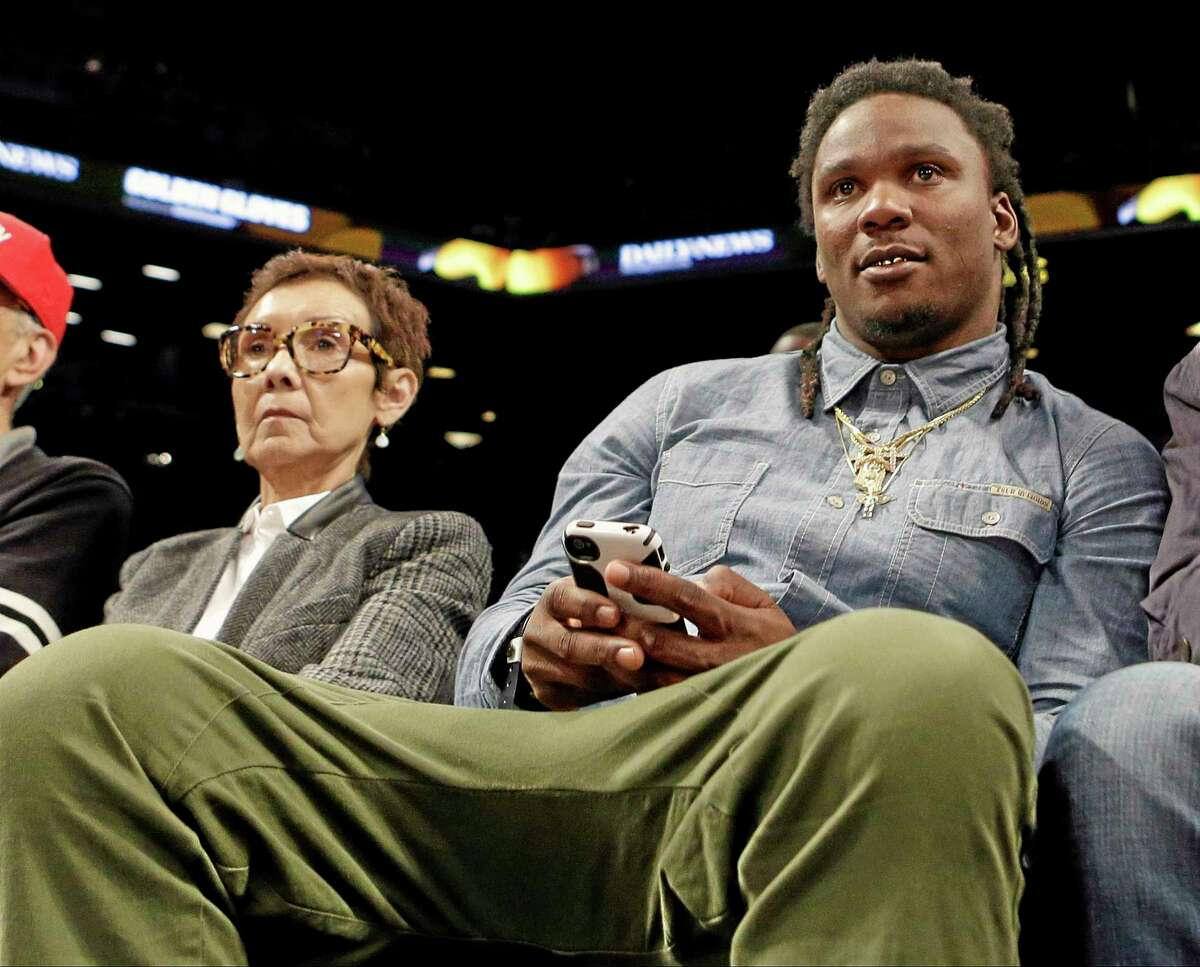 Former Tennessee Titans running back Chris Johnson watches the second half of the New York Knicks/Brooklyn Nets game on Tuesday in New York. Johnson and the Jets agreed on a deal Wednesday.