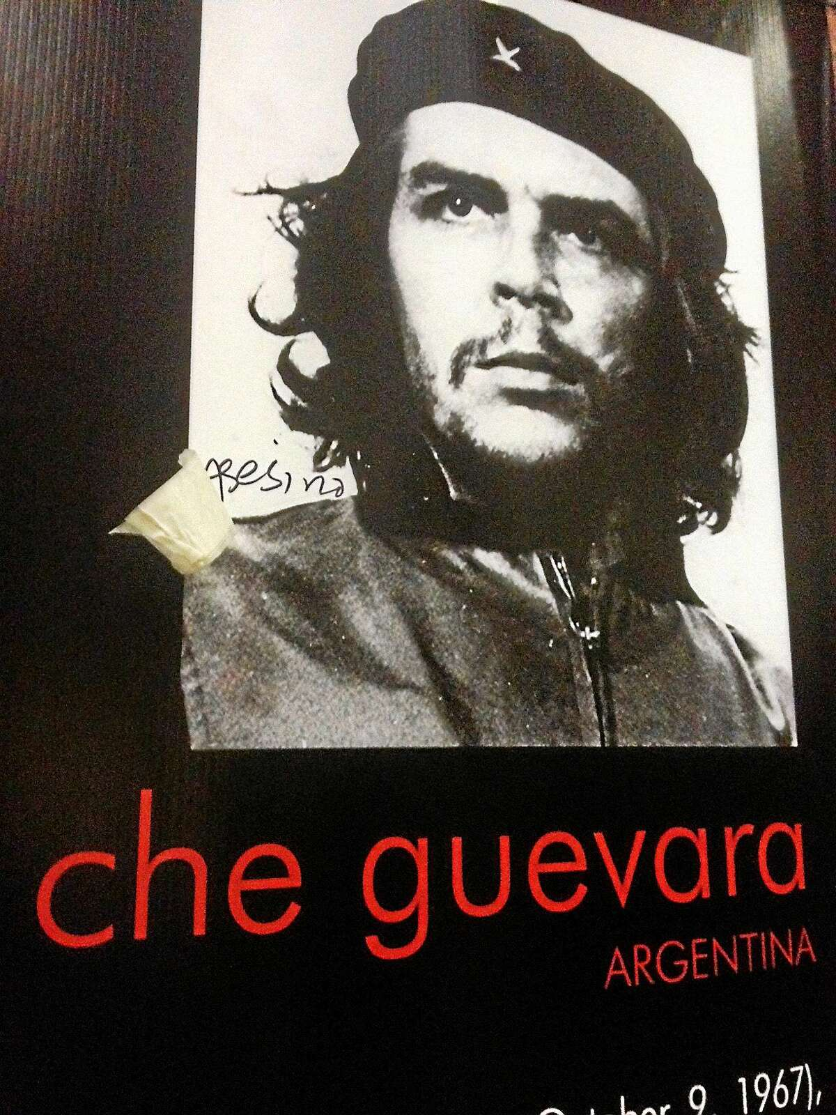 """The Spanish word for """"murderer"""" is seen scrawled on a poster of Che Guevara at New Haven City Hall."""