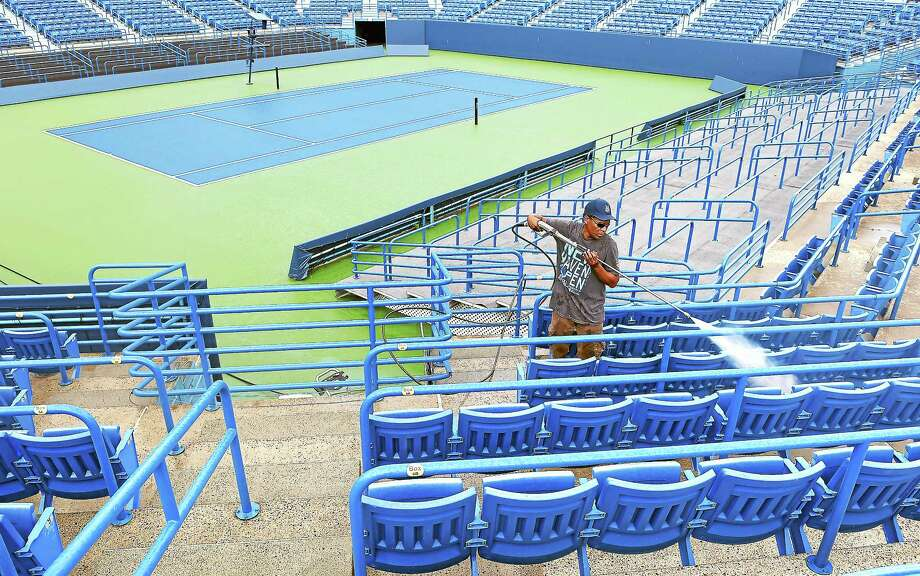 (Arnold Gold-New Haven Register)  Edgar Miller, owner of Miller Construction Services, pressures washes the stands at Stadium Court at the Connecticut Tennis Center on 8/4/2014. Photo: Journal Register Co.