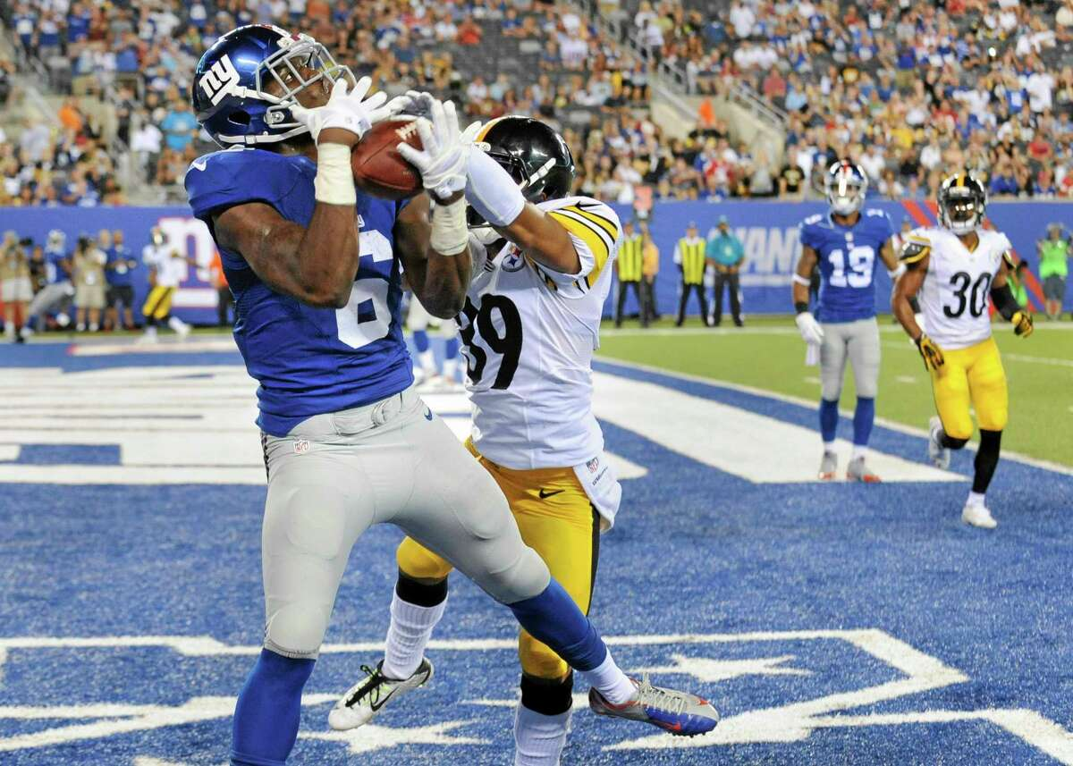 Giants wide receiver Corey Washington (6) makes a catch for a touchdown against Pittsburgh Steelers defensive back Isaiah Green (39) in the fourth quarter of Saturday's exhibition game.