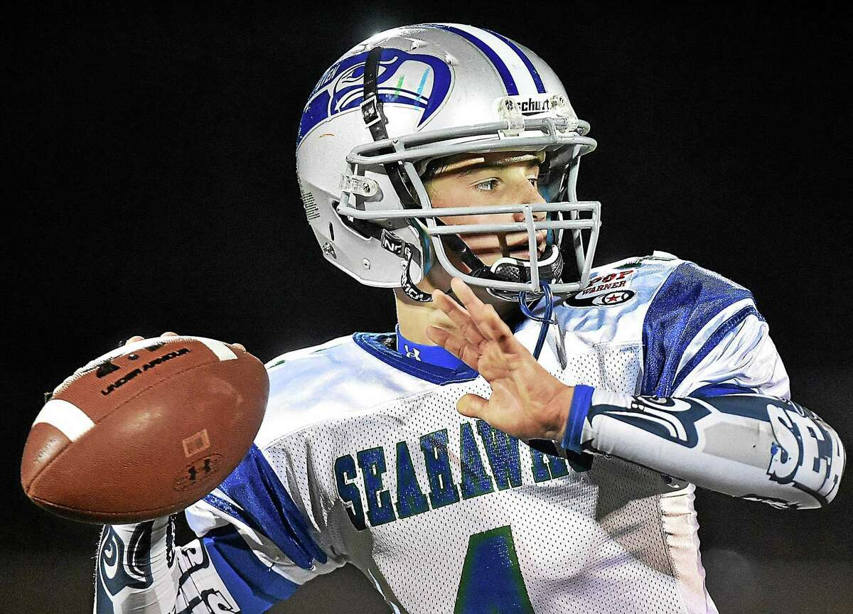 (Catherine Avalone - New Haven Register) West Haven Seahawks quarterback Zack Conlan looks to make a pass at practice Wednesday night, December 3, 2014 at the Veterans Memorial Field in West Haven. The West Haven Seahawks, of the Southern Connecticut League defeated the two-time Division I New England Junior Midget champion, Dorcester Eagles of Mass. 7-6 on November 29, 2014. The Seahawks will travel to Florida to play in the 2014 Pop Warner Super Bowl from December 6 - 13, 2014 at the ESPN Wide World of Sports Complex in Lake Buena Vista, Florida.