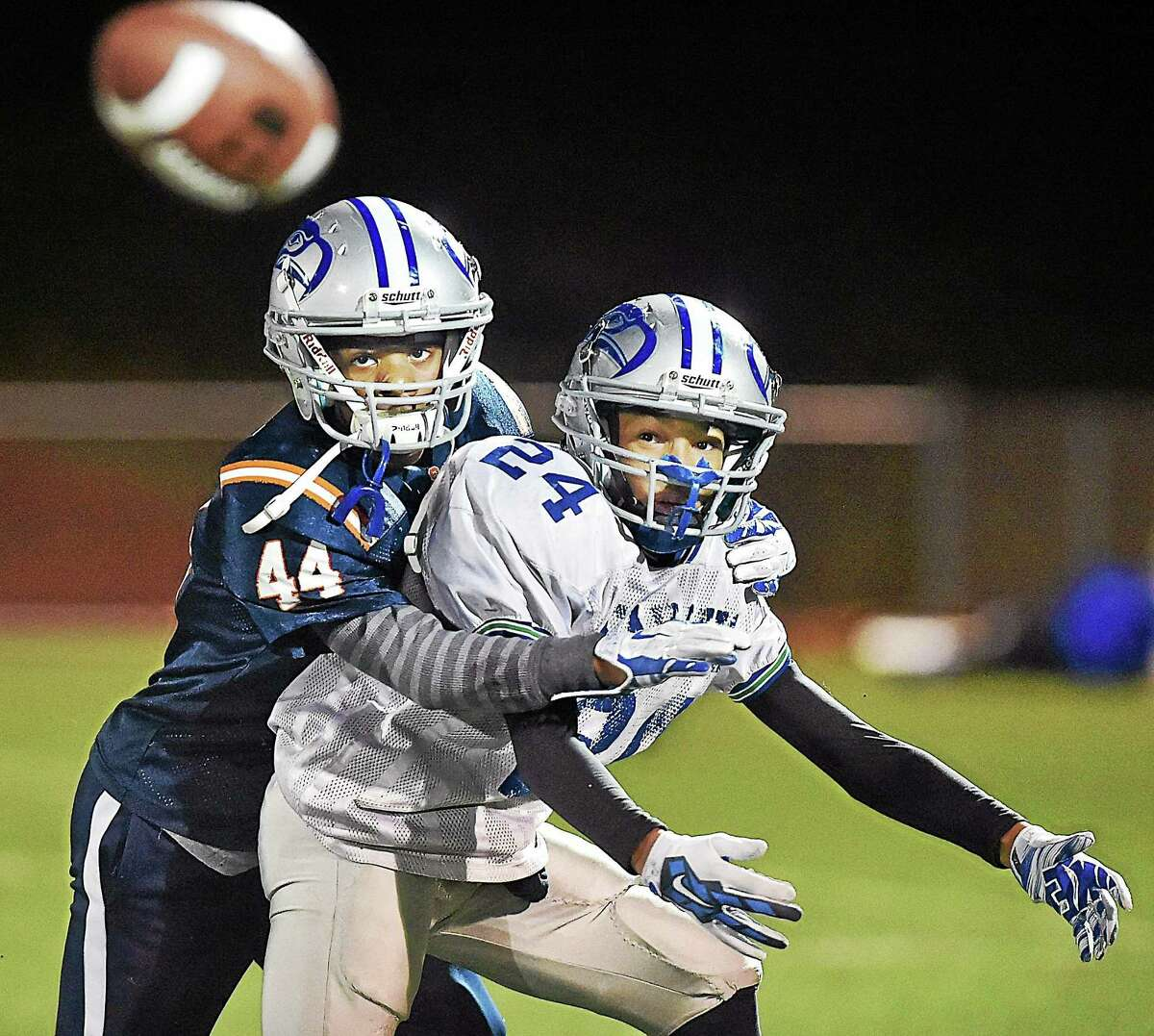(Catherine Avalone - New Haven Register) Jordan Berrios (24) and Jaden Shirden (44) run through an offensive play at a West Haven Seahawks at practice Wednesday night, December 3, 2014 at the Veterans Memorial Field in West Haven. The Seahawks defeated the two-time Division I New England Junior Midget champion, Dorcester Eagles of Mass. 7-6 on November 29, 2014 and will compete in the 2014 Pop Warner Super Bowl at the ESPN Wide World of Sportsô Complex in Lake Buena Vista, Florida from December 6 - 13, 2014.
