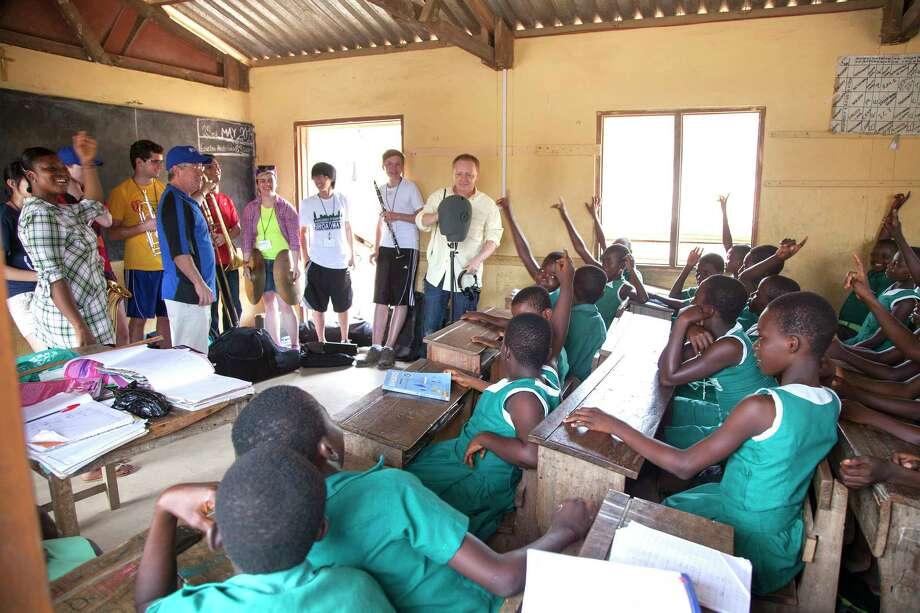 Dan Astmann/Yale  Duffy and students address a school room in Ghana. Photo: Journal Register Co.