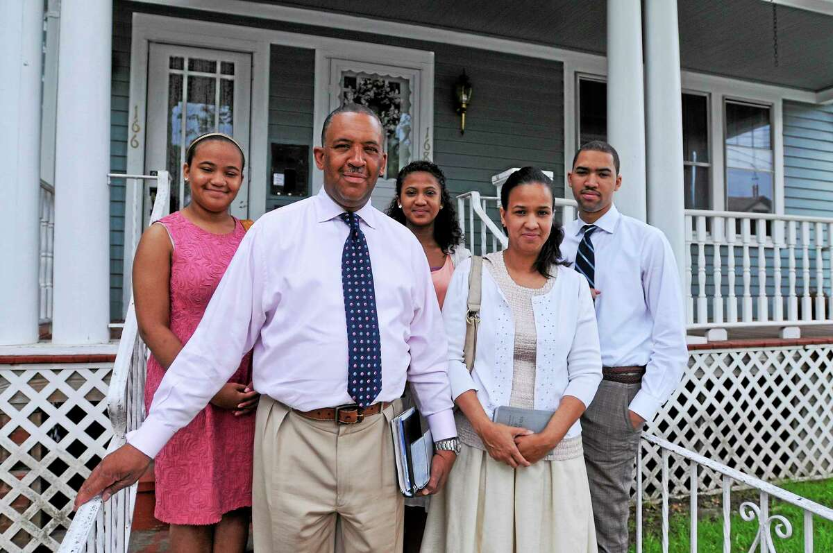 (Peter Casolino-New Haven Register) The Lee family are members of Jehovah's Witnesses. They are; Jeffrey and Martha, front, and their three children, left to right, rear; Allison, 13, Juliet, 15, and Jeffrey Jr., 19. June 10, 2014. pcasolino@newhavenregister.com