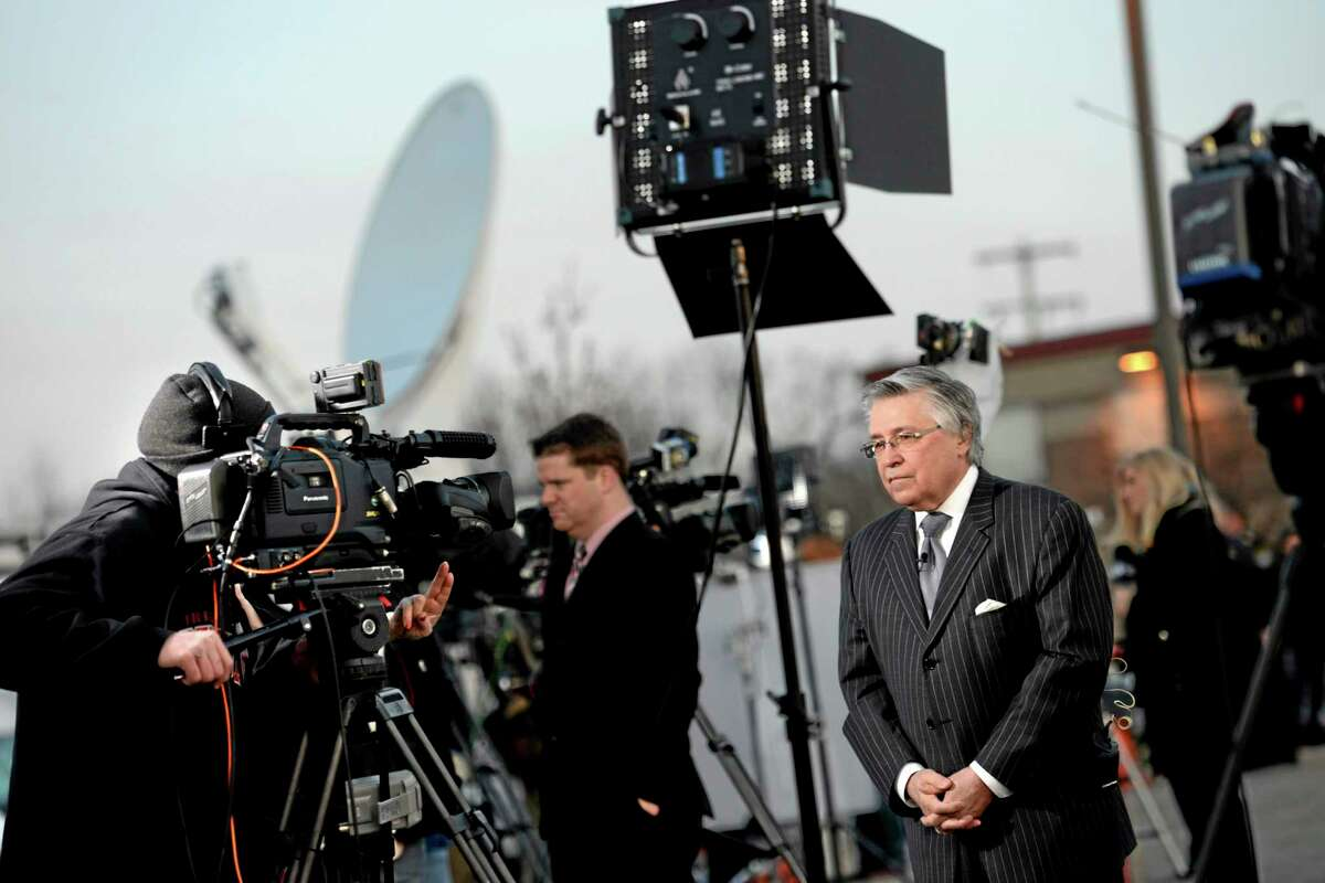 Patrick Thomassey, defense attorney for Alex Hribal, does a live television interview outside Franklin Regional High School, Thursday morning, April 10, 2014, Murrysville, Pa. Authorities have charged Hribal, 16, with four counts of attempted homicide and 21 counts of aggravated assault in a stabbing attack at the school on April 9. (AP Photo/Tribune Review, Sean Stipp) PITTSBURGH OUT