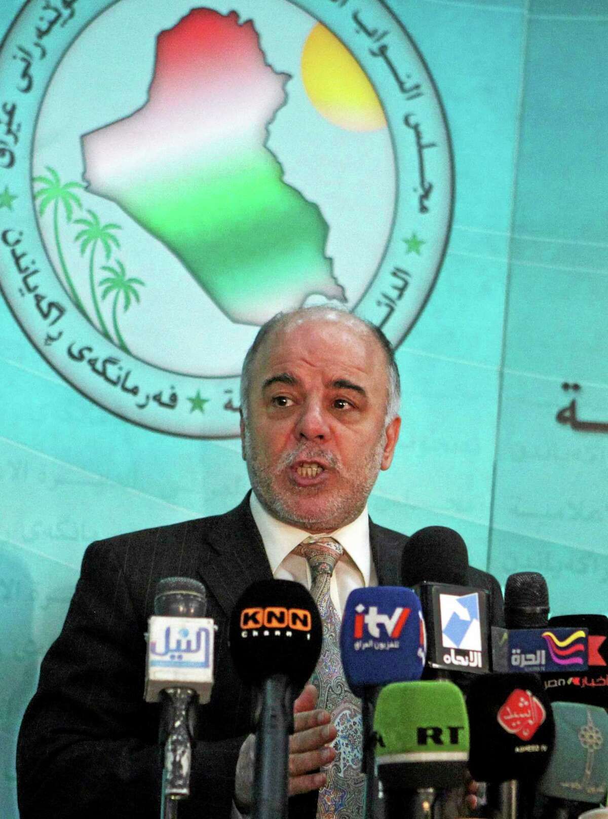 FILE - In this Saturday, Dec. 5, 2009 file photo, Shiite lawmaker Haider al-Ibadi speaks to the press after an Iraqi Parliament session about the election law in Baghdad, Iraq. On Monday, Aug. 11, 2014, Iraq's largest coalition of Shiite political parties chose the Deputy Parliament Speaker Haider al-Ibadi to be its candidate to lead the government in a major defeat for incumbent Prime Minister Nouri al-Maliki just hours after he declared himself the rightful candidate and put troops on the street. Critics say the Shiite al-Maliki contributed to the crisis by monopolizing power and pursuing a sectarian agenda that alienated the country's Sunni and Kurdish minorities. (AP Photo/Karim Kadim, File)