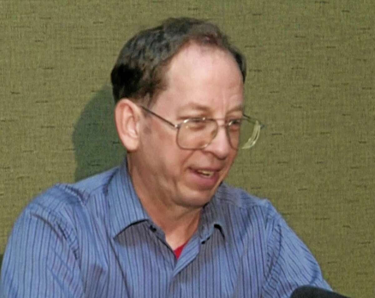 """FILE - In this Friday, Aug. 1, 2014, file image taken from video, U.S. citizen Jeffrey Edward Fowle speaks at an undisclosed location in North Korea. The family of Fowle, who has been charged with """"anti-state"""" crimes in North Korea, is expected to attend a news conference in an effort to help his case, about 10 days after he pleaded with the U.S. government to intervene. (AP Photo/APTN, File)"""