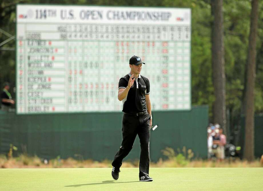 Martin Kaymer walks in front of the U.S. Open leaderboard, which at the end of the second round showed Kaymer in front by six strokes. Photo: Chuck Burton — The Associated Press   / AP