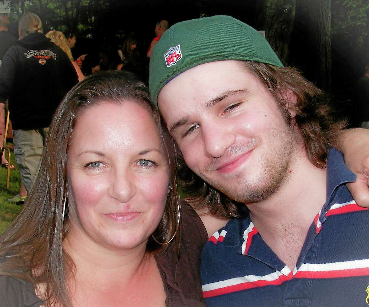 This 2012 photo provided by Sandy Bannon shows Margaret Rohner, left, with her son Bobby Rankin. The day after Christmas 2013, Rohner, 45, was viciously attacked with a fireplace poker, her eviscerated body left in the living room of her Deep River, Conn., home. Rankin, 23, was charged with her murder. (AP Photo/Sandy Bannon)