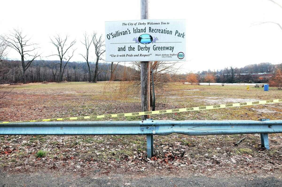 Caution tape prevents pedestrians from entering O'Sullivan's Island Recreation Park in Derby.