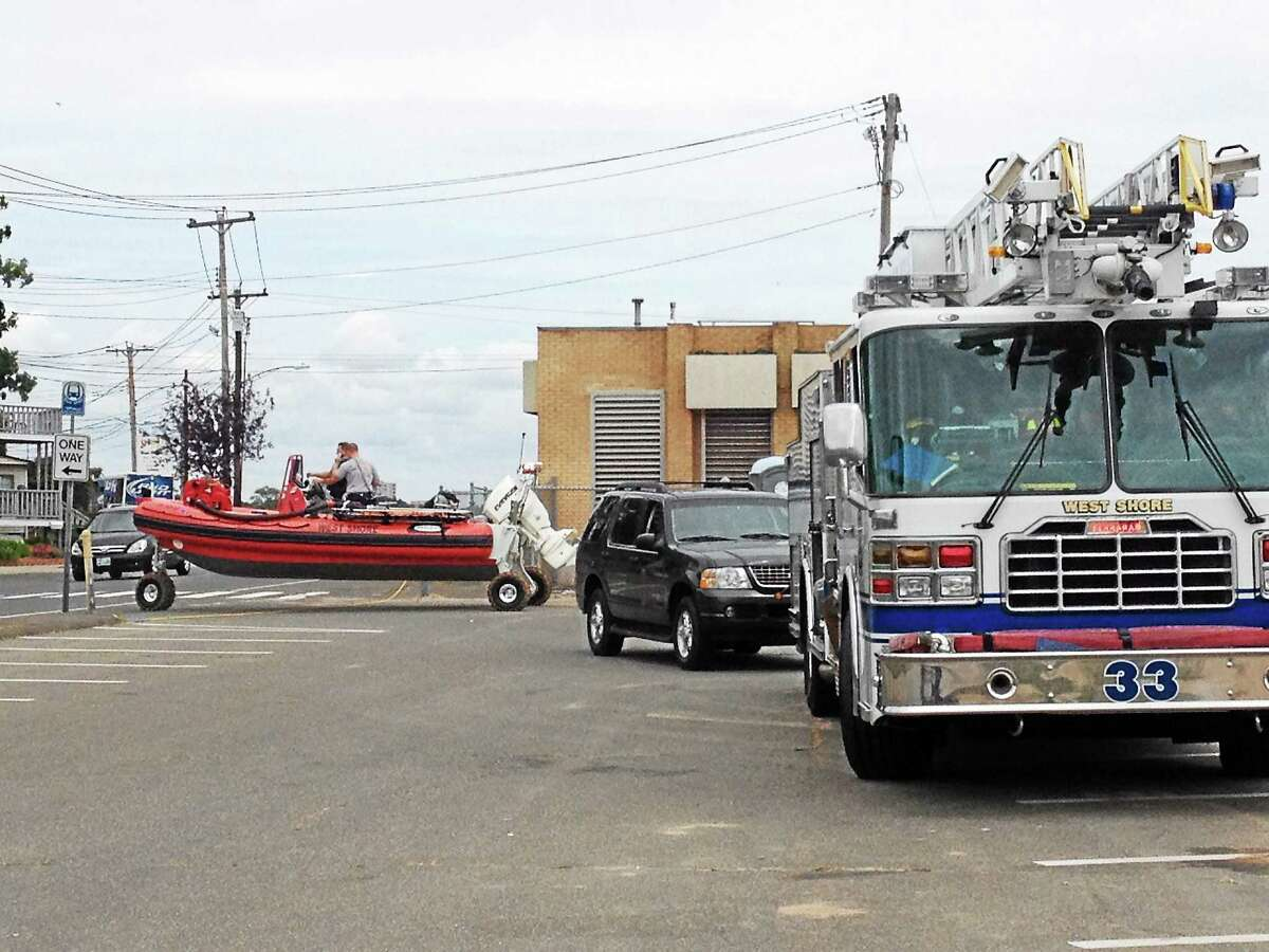 West Shore firefighters rescued three fisherman who became stranded Tuesday on the rocks near Prospect Beach in West Haven. The three men were not hurt but were being evaluated for hypothermia.