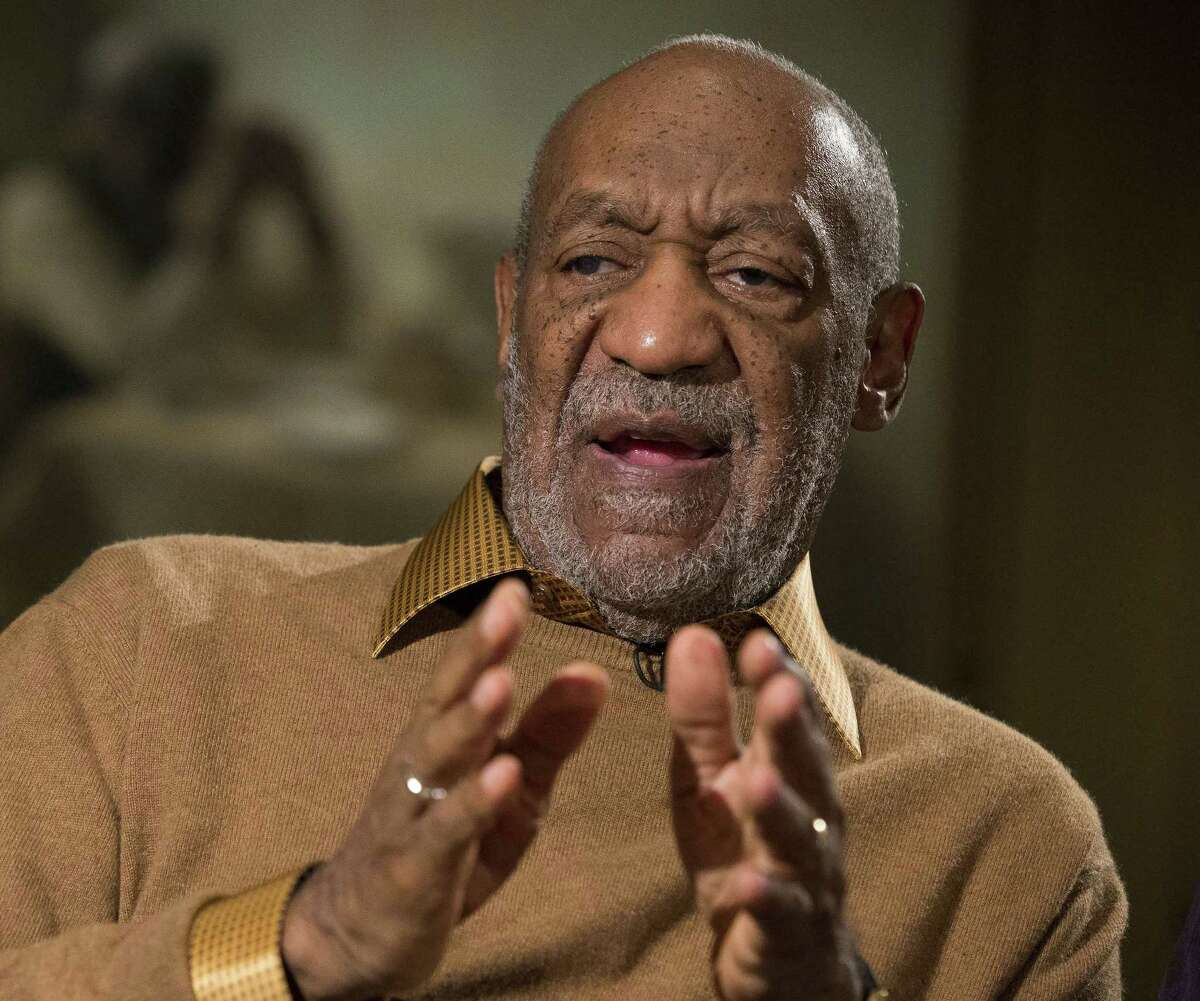 """FILE - In this Nov. 6, 2014 file photo, entertainer Bill Cosby gestures during an interview about the upcoming exhibit, """"Conversations: African and African-American Artworks in Dialogue, """" at the Smithsonian's National Museum of African Art, in Washington. A Southern California woman has sued Cosby, claiming the comedian molested her around 1974 when she was 15 years old. Judith Huth claims in the sexual battery lawsuit filed Tuesday, Dec. 2, 2014. in Los Angeles that the molestation occurred in a bedroom of the Playboy Mansion. (AP Photo/Evan Vucci, File)"""