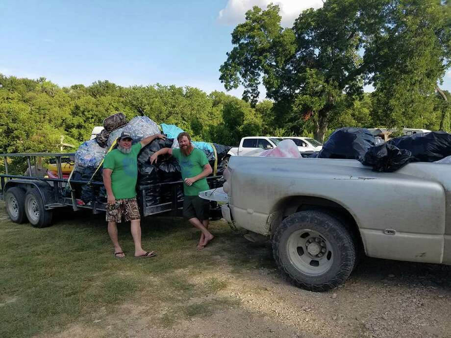 Volunteers efforts to clean San Marcos River during Float Fest is estimated to have gathered over 5,000 cans from water. Photo: Courtesy Zach Halfin