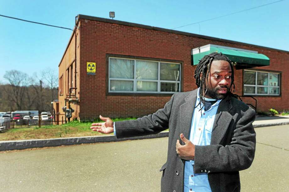Standing at the New Haven Police Academy on Sherman Avenue, Rodney Williams speaks out Wednesday against the police gun range's location near schools. Photo: Peter Hvizdak — New Haven Register      / ©Peter Hvizdak /  New Haven Register