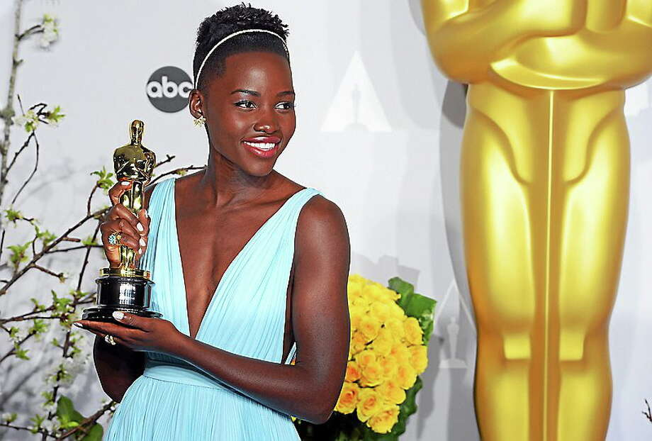 Lupita Nyong'o , who won the Oscar for Performance by an Actress in a Supporting Role, backstage at the 86th Academy Awards at the Dolby Theatre in Hollywood, California on Sunday March 2, 2014 (Photo by David Crane / Los Angeles Daily News) Photo: Journal Register Co.