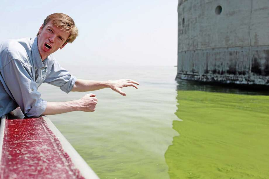 Collin O'Mara, president and CEO of the National Wildlife Federation, gestured as he talked about algae near the City of Toledo water intake crib, Sunday, Aug. 3, 2014, in Lake Erie, about 2.5 miles off the shore of Curtice, Ohio.  (AP Photo/Haraz N. Ghanbari) Photo: AP / AP
